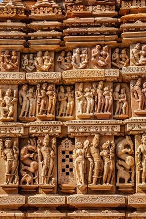 tourist site: Stone carving bas relief sculptures on Vaman Temple, famous indian tourist site Khajuraho, Madhya Pradesh, India