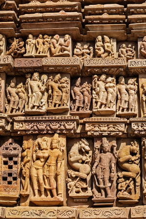 carvings: Stone carving bas relief sculptures on Vaman Temple, famous indian tourist site Khajuraho, Madhya Pradesh, India
