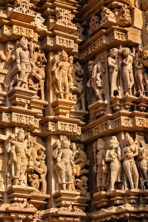 madhya: Stone carving bas relief sculptures on Vaman Temple, famous indian tourist site Khajuraho, Madhya Pradesh, India