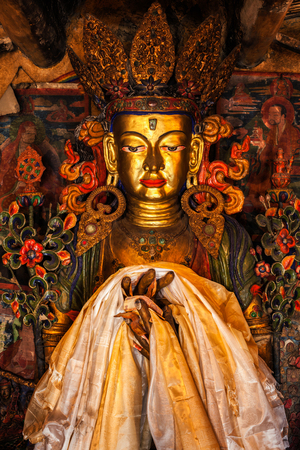 statuary: Maitreya Buddha statue close up Tibetan monastery Thiksey Gompa. Ladakh, Jammu and Kashmir, India Stock Photo