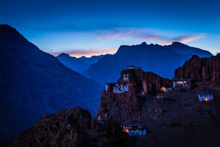 Dhankar gompa tibetan monastery in Himalayas in twilight. Spiti valley, Himachal Pradesh, India Stock Photo