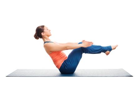 utthita: Beautiful sporty fit woman doing Ashtanga Vinyasa yoga asana Paripurna navasana - boat pose beginner variation isolated on white background