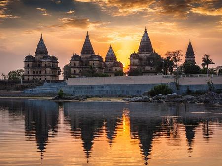 architectural exteriors: View of Royal cenotaphs of Orchha over Betwa river. Orchha, Madhya Pradesh, India Stock Photo