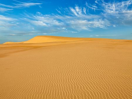 ne: White sand dunes in desert on sunrise, Mui Ne, Vietnam. Stock Photo