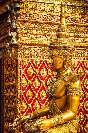 thai temple: Gold sitting Buddha statue in Wat Phra That Doi Suthep, Chiang Mai, Thailand