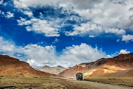 unsurfaced road: Indian lorry on Trans-Himalayan Manali-Leh highway in Himalayas. Ladakh, Jammu and Kashmir, India Stock Photo