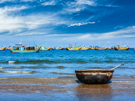 nam: Coracle and fishing boats on beach in Mui Ne, Phan Tiet, Vietnam