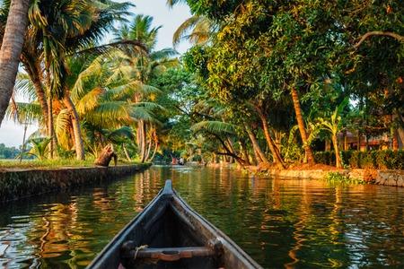 backwaters: Kerala backwaters tourism travel in canoe. Kerala, India