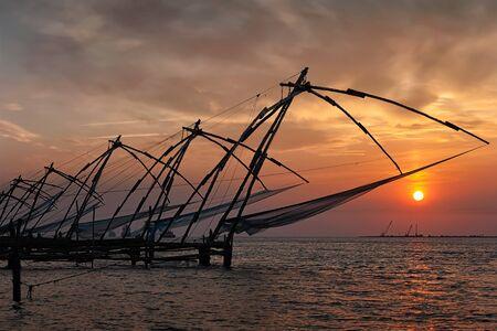 fishnets: Kochi tourist attraction - chinese fishnets on sunset. Fort Kochin, Kochi, Kerala, India