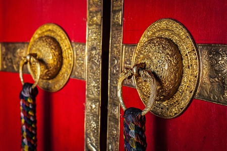 pradesh: Decorated door handles of Kee gompa Tibetan Buddhist monastery. Ki, Spiti valley, Himachal Pradesh, India