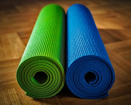yogic: Yoga concept background - yoga mats on wooden floor