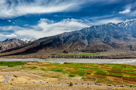 unsurfaced road: View of Spiti valley and Spiti river in Himalayas. Spiti valley, Himachal Pradesh, India
