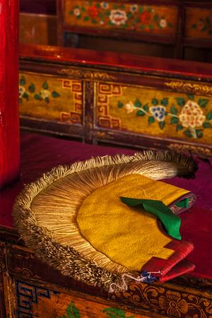 gelugpa: Yellow hat (attribute of  Gelug sect of Buddhism) in Likir Gompa (Tibetan Buddhist monastery). Ladakh, India Stock Photo