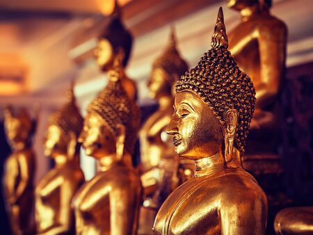 buddhist's: Vintage retro effect filtered hipster style image of golden Buddha statues in buddhist temple Wat Saket (The Golden Mount), Bangkok, Thailand