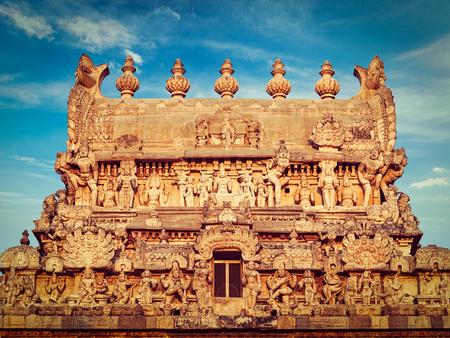 tamil nadu: Vintage retro effect filtered hipster style image of entrance tower (gopura) of Periyanayaki Amman Temple against sky. Airavatesvara Temple, Darasuram, Tamil Nadu, India