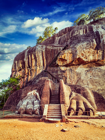 Vintage retro effect filtered hipster style image of famous Sri Lankan tourist landmark - lion's paws pathway on Sigiriya rock, Sri Lanka