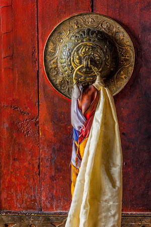 gompa: Door handle of gates of Thiksey gompa (Tibetan Buddhist monastery). Ladakh, India