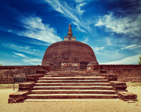 dagoba: Vintage retro effect filtered hipster style image of Sri Lankan tourist landmark - ruins of Rankot Vihara - Buddhist dagoba (stupa).  Pollonaruwa, Sri Lanka
