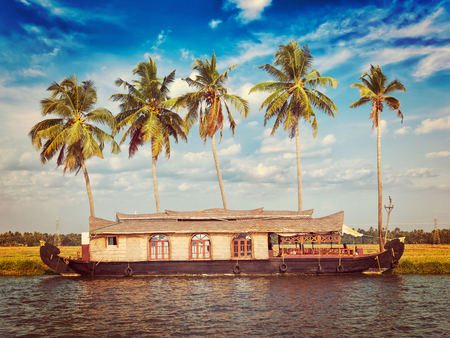 backwaters: Kerala India tourism travel concept background - vintage retro effect filtered hipster style image of Houseboat on Kerala backwaters. Kerala, India Stock Photo