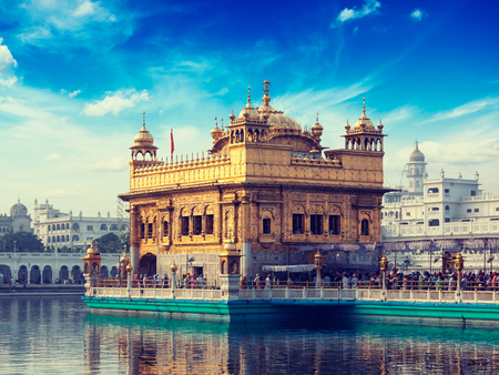harmandir sahib: Vintage retro effect filtered hipster style image of famous indian toursit landmark and sacred pilgrimage site - Sikh gurdwara Golden Temple (Harmandir Sahib). Amritsar, Punjab, India Stock Photo