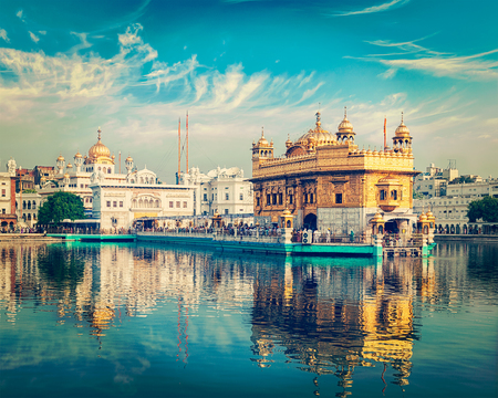 temple tank: Vintage retro effect filtered hipster style image of famous indian toursit landmark and sacred pilgrimage site - Sikh gurdwara Golden Temple (Harmandir Sahib). Amritsar, Punjab, India Stock Photo