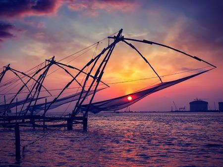 fishnets: Vintage retro effect filtered hipster style image of Kochi chinese fishnets on sunset. Fort Kochin, Kochi, Kerala, India
