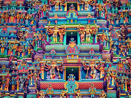 tamil nadu: Vintage retro effect filtered hipster style image of statues on Hindu temple gopura (tower). Menakshi Temple, Madurai, Tamil Nadu, India