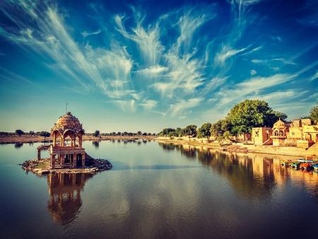 jaisalmer: Vintage retro effect filtered hipster style image of Indian landmark Gadi Sagar - artificial lake. Jaisalmer, Rajasthan, India