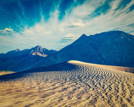 fade: Vintage retro effect filtered hipster style image of sand dunes in Nubra valley in Himalayas. Hunder, Nubra valley, Ladakh