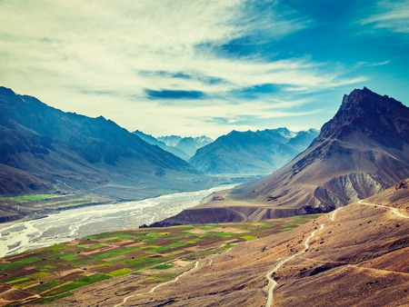 unsurfaced road: Vintage retro effect filtered hipster style image of Spiti valley and Spiti river in Himalayas. Spiti valley, Himachal Pradesh, India