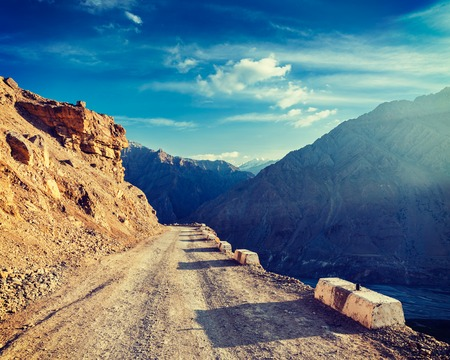 pradesh: Vintage retro effect filtered hipster style image of road in Himalayas. Spiti Valley, Himachal Pradesh, India Stock Photo