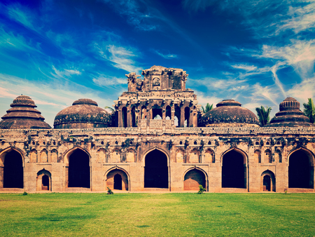horizontals: Travel India Karnataka tourism - vintage retro effect filtered hipster style image of Ancient ruins of Elephant Stables, Royal Centre. Hampi, Karnataka, India. Stitched panorama