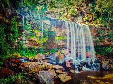 Vintage retro effect filtered hipster style image of tropical waterfall. Popokvil Waterfall, Bokor National Park, Cambodia Stock Photo