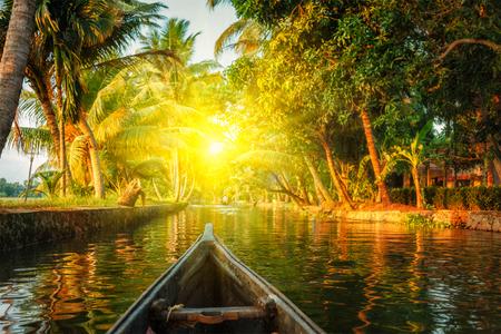 kerala: Kerala backwaters tourism travel in canoe on sunset. Kerala, India