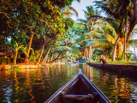backwaters: Vintage retro effect hipster style image of Kerala backwaters tourism travel in canoe. Kerala, India Stock Photo