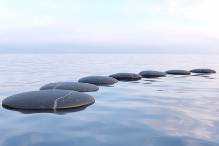 Zen stones in water with reflection - peace meditation relaxation concept