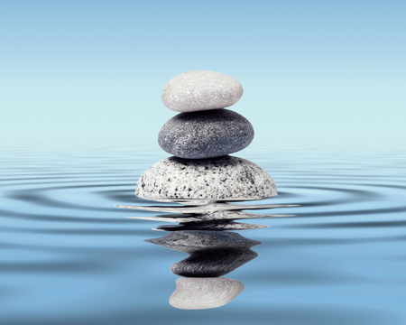 fengshui: Zen stones in water with reflection - peace balance meditation relaxation concept