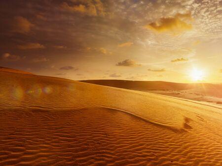 ne: White sand dunes on sunrise, Mui Ne, Vietnam. With lens flare and light leak Stock Photo