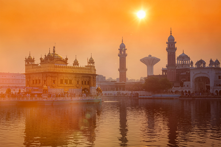 temple tank: Sikh gurdwara Golden Temple (Harmandir Sahib) on sunrise. Amritsar, Punjab, India. With light leak and lens flare
