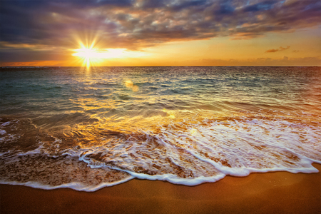 sunsets: Beach holidays vacation background - calm ocean during tropical sunrise Stock Photo