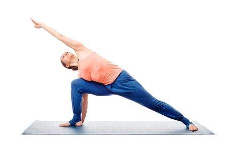 ashtanga: Woman doing Ashtanga Vinyasa Yoga asana Utthita parsvakonasana - extended side angle pose posture advanced variation isolated on white background Stock Photo