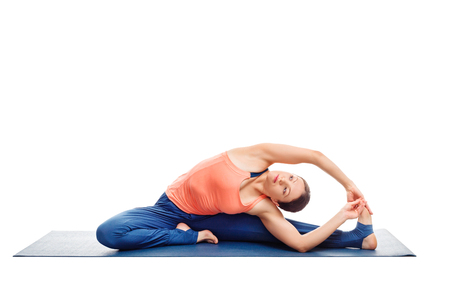 janu: Beautiful sporty fit woman doing yoga asana parivrtta janu sirsasana - revolved head-to-knee pose posture isolated on white background Stock Photo