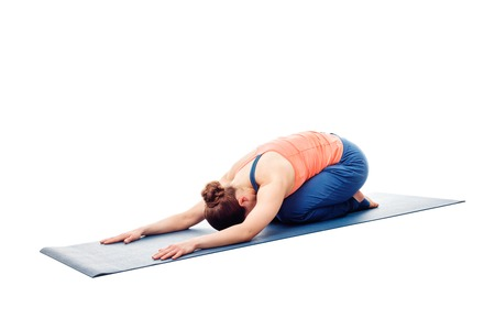 asana: Woman doing Ashtanga Vinyasa Yoga relaxation asana Balasana - child posture - resting pose or counter asana for many asanas isolated on white background