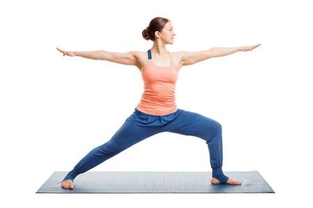 Woman doing Ashtanga Vinyasa Yoga asana Virabhadrasana 2 - warrior pose 2 isolated on white 写真素材