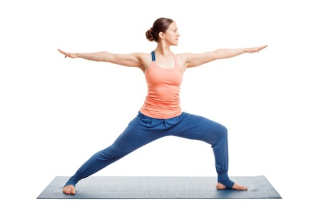 Woman doing Ashtanga Vinyasa Yoga asana Virabhadrasana 2 - warrior pose 2 isolated on white Standard-Bild