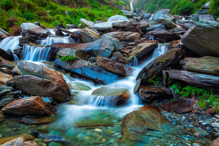 stream: Cascade of tropical waterfall in Himalayas. Bhagsu, Himachal Pradesh, India. Polarizer filter used