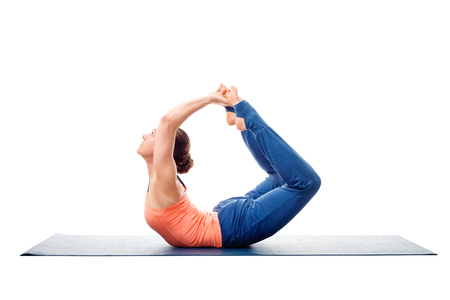 Sporty fit woman dooing yoga back bend asana Dhanurasana - bow pose isolated on white