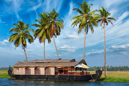 backwater: Kerala travel tourism background - houseboat on Kerala backwaters. Kerala, India