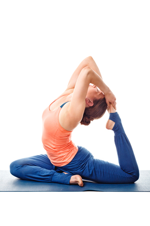 eka: Sporty fit yogini woman doing yoga asana Eka pada kapotasana - one-legged pigeon pose posture isolated on white