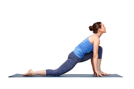 lunge: Beautiful sporty fit yogini woman practices yoga asana Anjaneyasana - low crescent lunge pose variation in surya namaskar in studio isolated on white Stock Photo